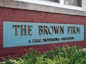 Cast Metal Letters That Say Brown Law Firm